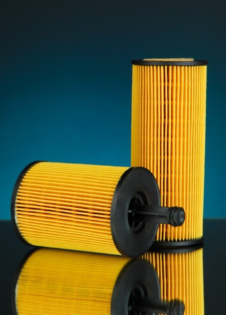 Car oil filters on dark color background photo