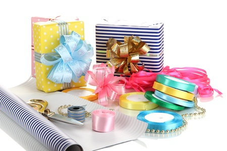 Materials and accessories for wrapping gifts with holiday gifts isolated on white photo