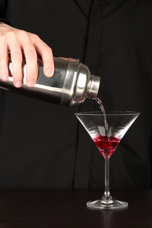 Bartender making cocktail on close-up photo
