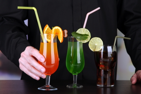 Bartender with different cocktails, close-up Stock Photo - 21622824