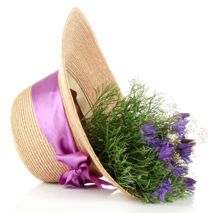 Bouquet of beautiful wild flowers in summer hat, isolated on white photo