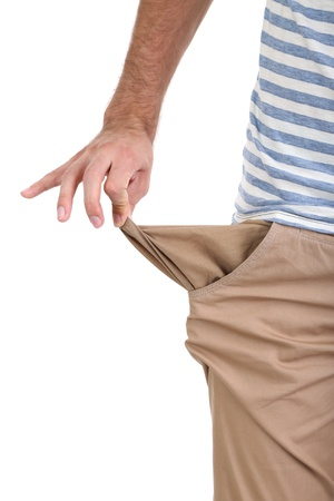 nothing: Man showing his empty pocket, isolated on white