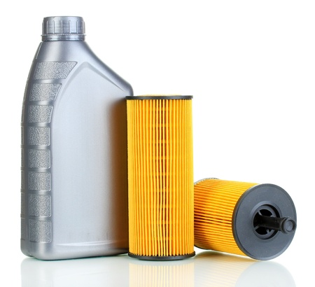 Car oil filters and motor oil can isolated on white photo