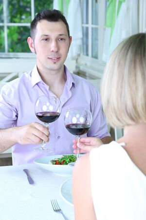 Beautiful couple having  romantic dinner at restaurant Stock Photo - 24367813