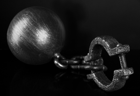 Ball and chain on black background photo