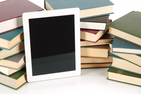 Tablet and books isolated on white photo