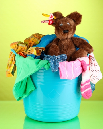 Blue laundry basket on green background Stock Photo - 21705037