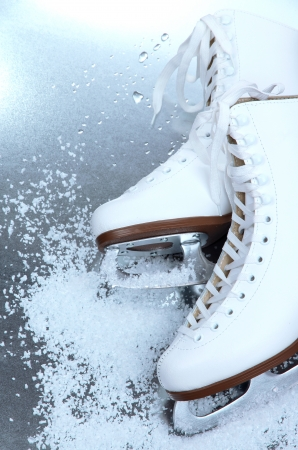 Figure skates in snow close-up photo