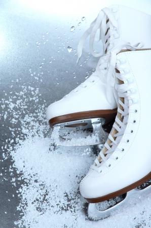 skating: Figure skates in snow close-up