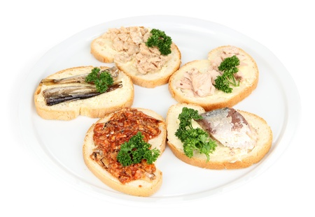 Tasty sandwiches with tuna and cod liver sardines different kinds of canned fish, isolated on white photo