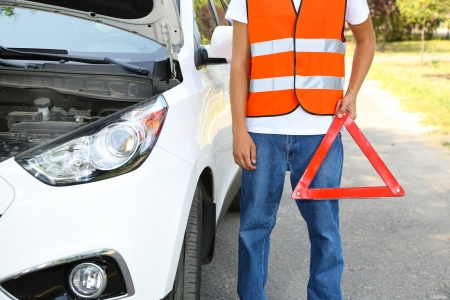 roadside assistance: Broken down car with red warning triangle Stock Photo