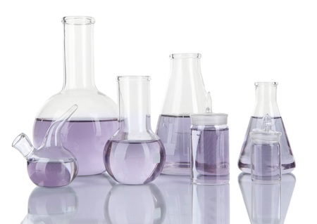 reagents: Test-tubes with light purple liquid isolated on white