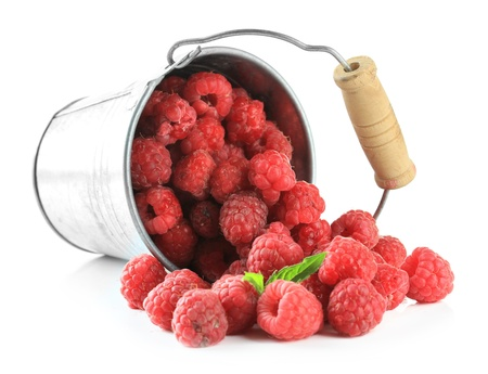 Ripe sweet raspberries in pail, isolated on white photo
