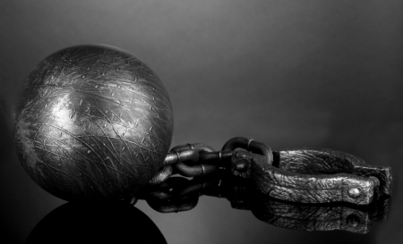 Ball and chain on grey background photo