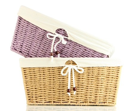 two empty color wicker baskets isolated on white photo