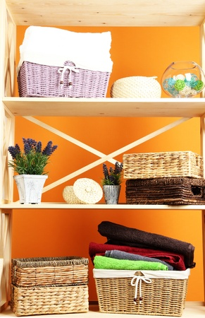 Beautiful white shelves with different home related objects, on color wall background Stock Photo - 21807017