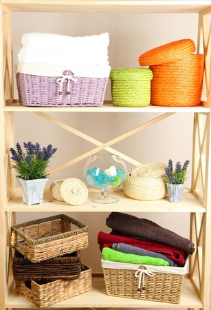 Beautiful white shelves with different home related objects, on color wall background Stock Photo - 21807023