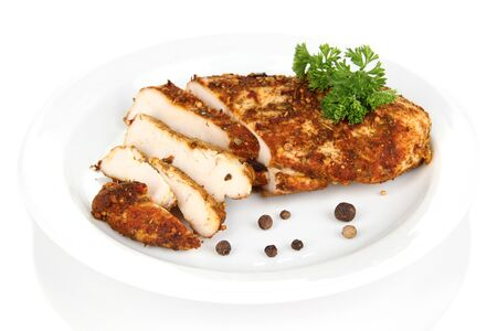 Roasted chicken fillets on white plate, isolated on white Stock Photo - 21807904