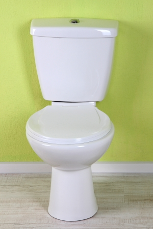 White toilet bowl in a bathroom photo