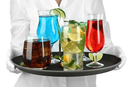 Waitresses holding tray with glasses of cocktails, isolated on white photo