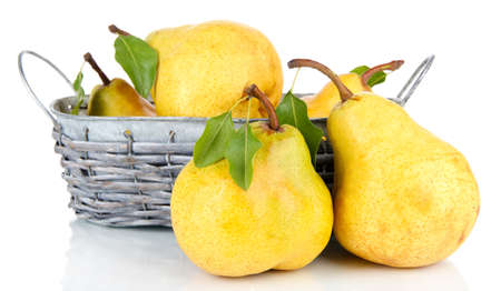 Juicy pears in wicker basket isolated on white photo