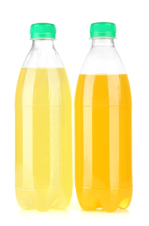 Bottles with tasty drinks, isolated on white photo