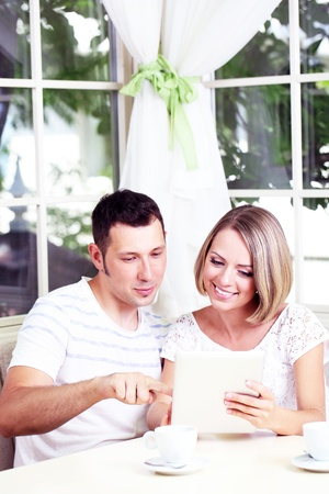 Young couple  taking  photo with tablet at home photo