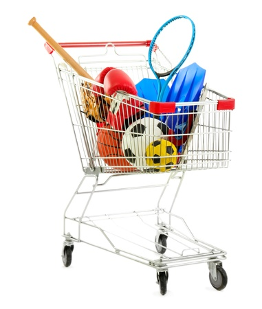 Shopping cart with sport equipment, isolated on white photo