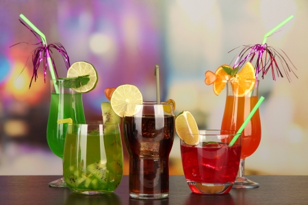 Set of different drinks on bright background photo