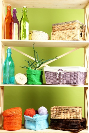 Beautiful white shelves with different home related objects, on color wall background Stock Photo - 21864713