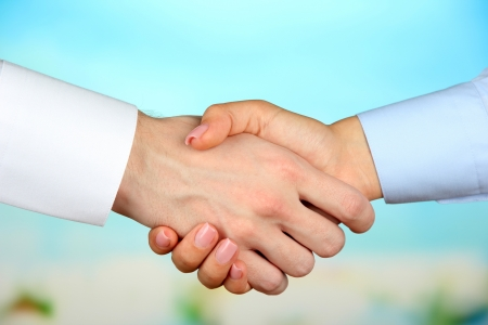 hand job: Business handshake on bright background
