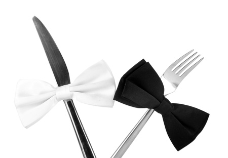 butterfly knife: Black and white bow ties  on fork and knife, isolated on white