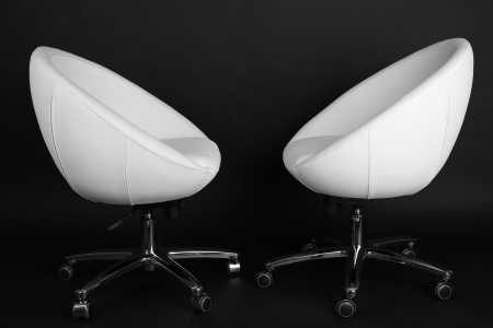 White chairs on black background photo