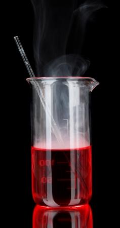 milliliters: Laboratory beaker on black background