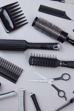Professional hairdresser tools on gray background Stock Photo