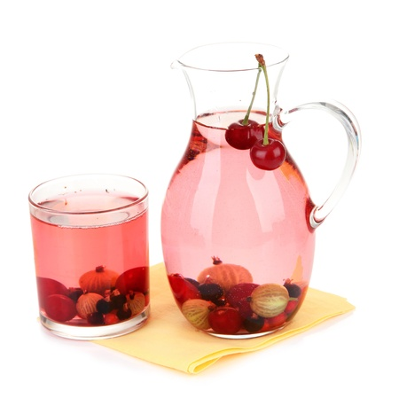 Pitcher of compote with summer berries isolated on white  photo