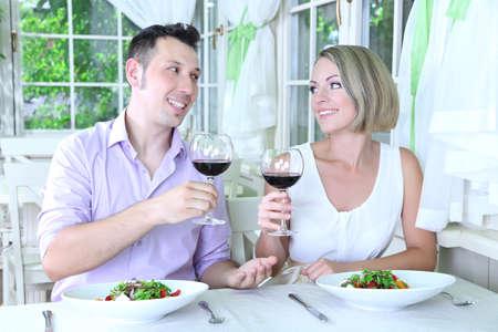 Beautiful couple having  romantic dinner at restaurant photo