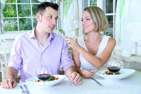 Beautiful couple having  romantic dinner at restaurant Stock Photo - 24367515