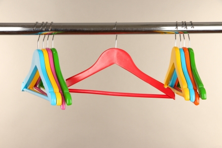 Colorful clothes hangers on gray background photo