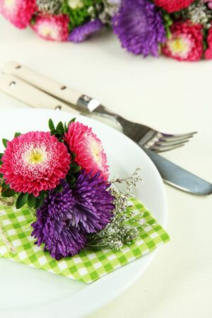 Festive dining table setting with flowers  Stock Photo - 22018397