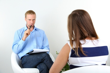 Woman with problem on reception for psychologist photo