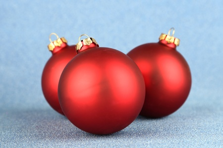 Christmas balls on blue background photo