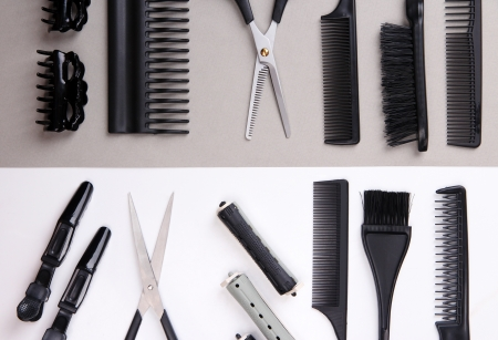 Professional hairdresser tools on white and gray background photo
