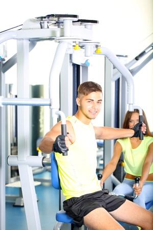 simulator: Guy and girl engaged in simulator at gym