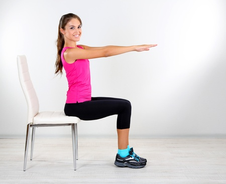 relaxation exercise: Beautiful young girl doing exercises at home
