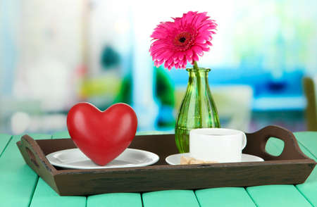 Wooden tray with breakfast, on  bright background photo