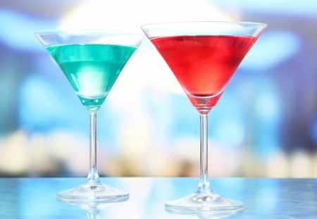 Cocktails on bright background photo