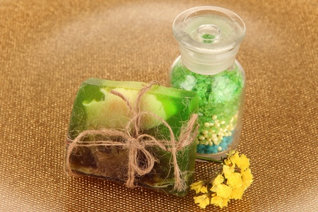 Hand made soap with sea salt on golden background photo