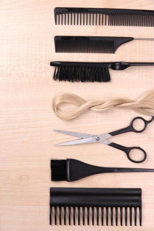 Professional hairdresser tools on table close-up photo