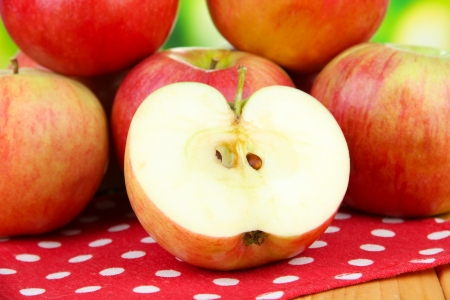 Ripe apples on  wooden table, on bright background photo